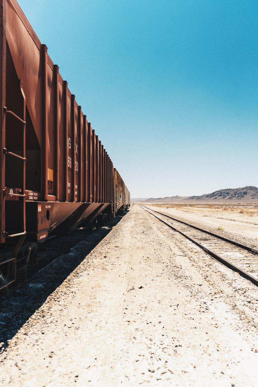 brown train on rail during daytime