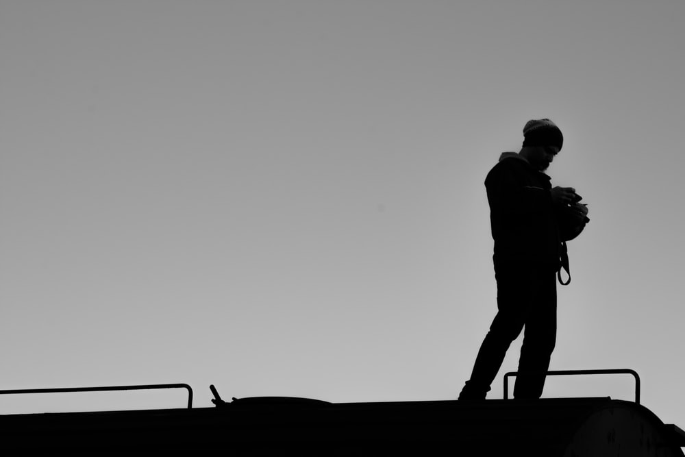 silhouette of man standing on the beach