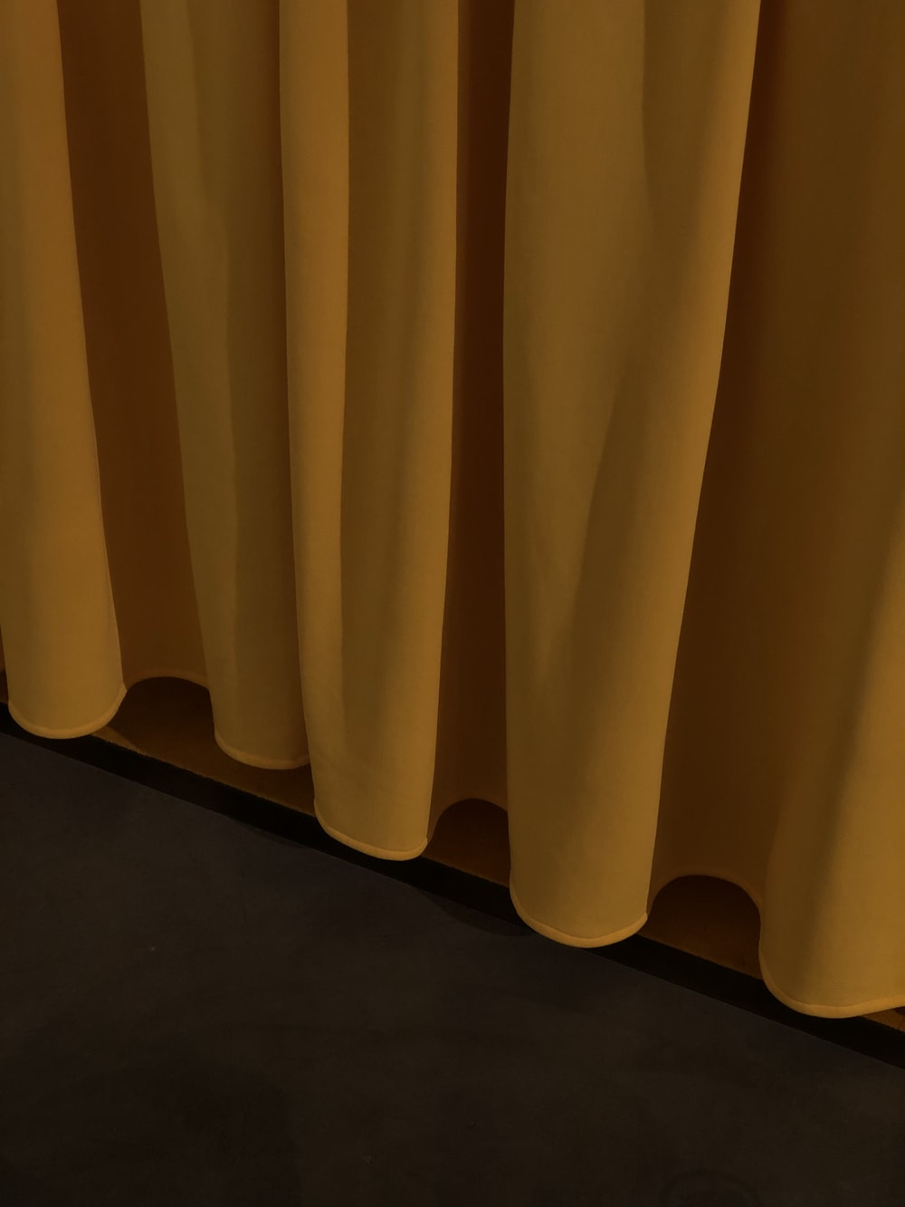 yellow curtain on brown wooden floor