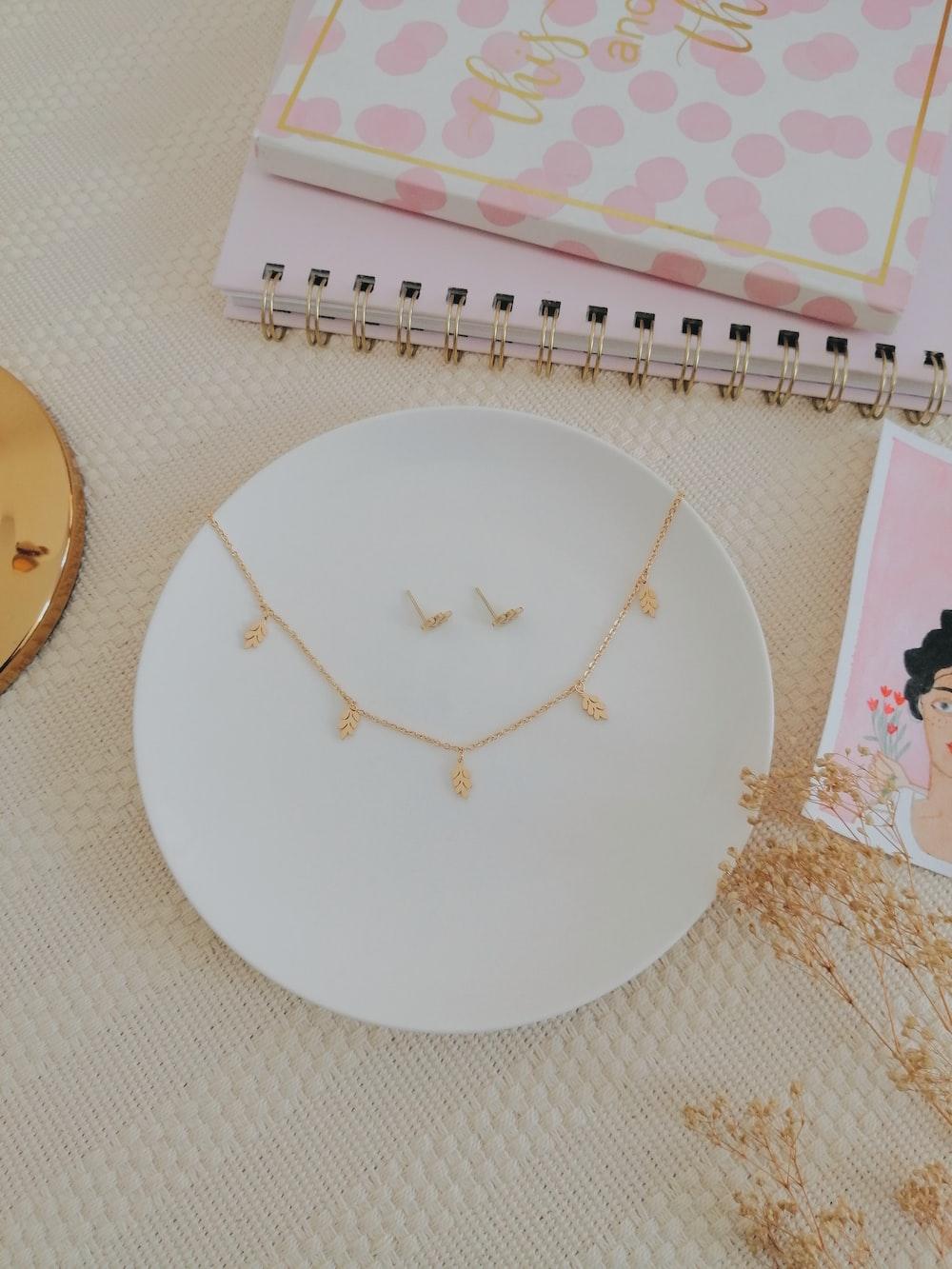 white round plate on white textile