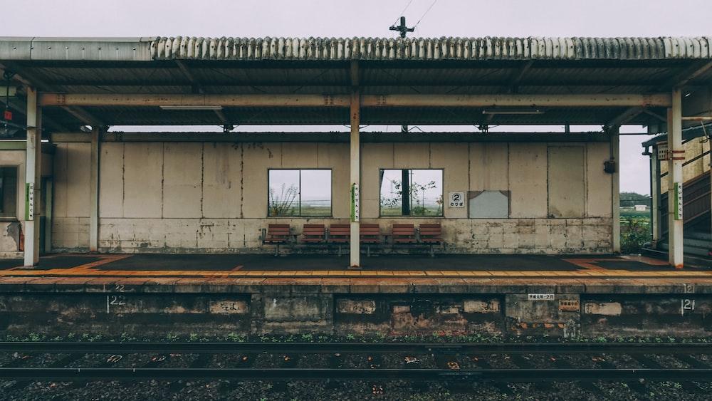 train rail near white building