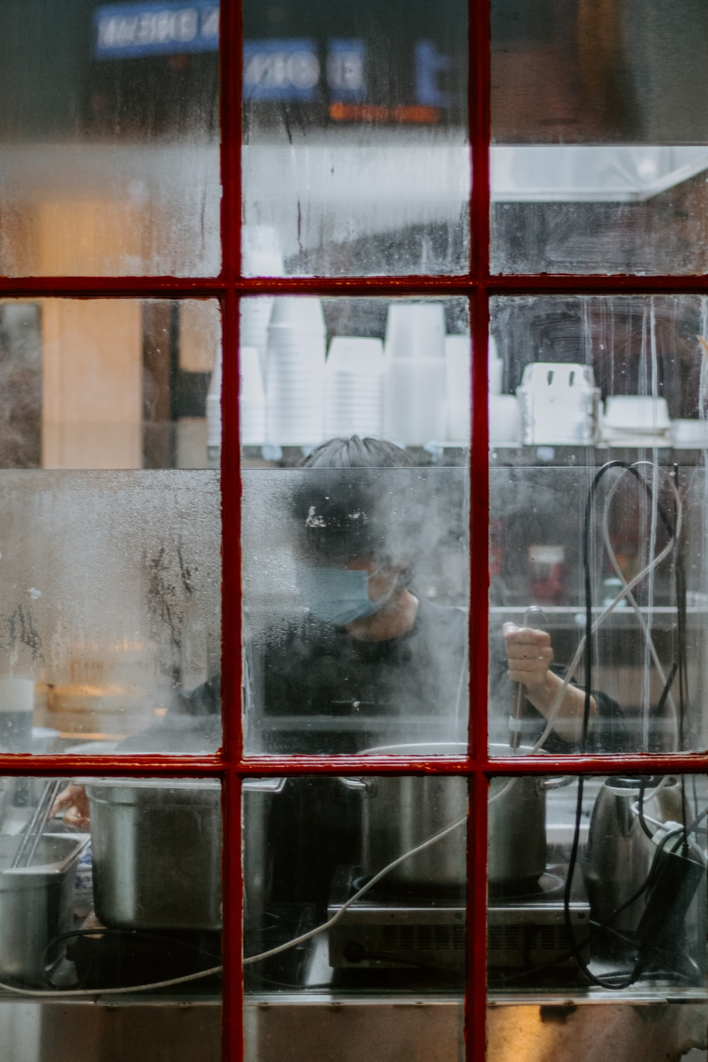 clear glass window with red frame