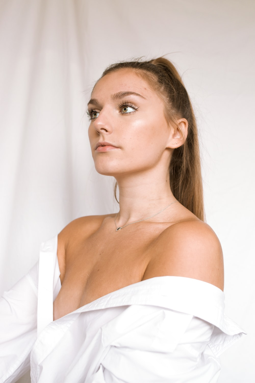 woman in white off shoulder shirt
