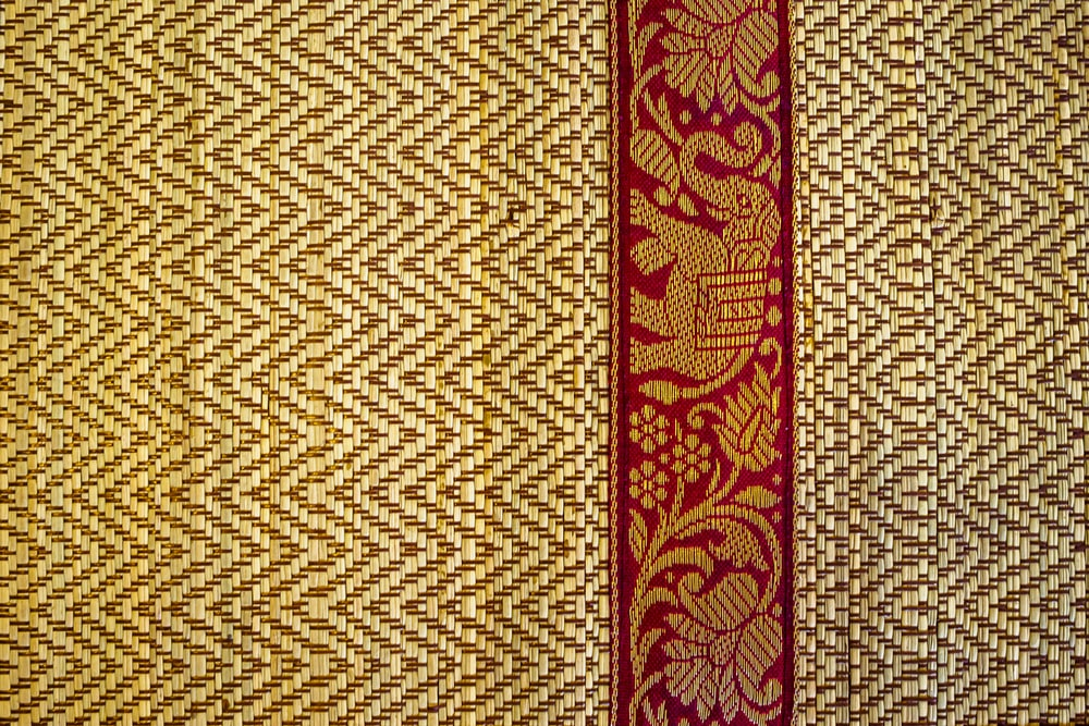 red and brown floral textile