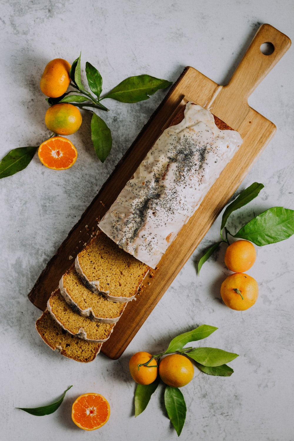 sliced of bread on brown wooden chopping board