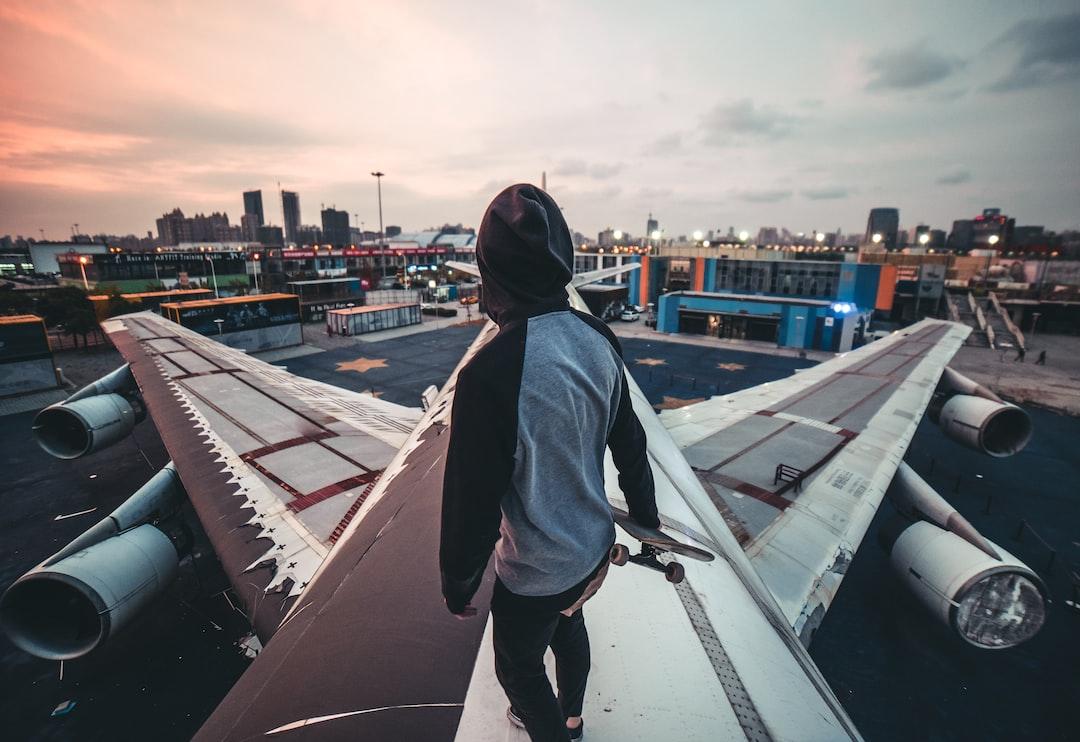 Man In Blue Denim Jacket Standing On Top of Building During Daytime - unsplash
