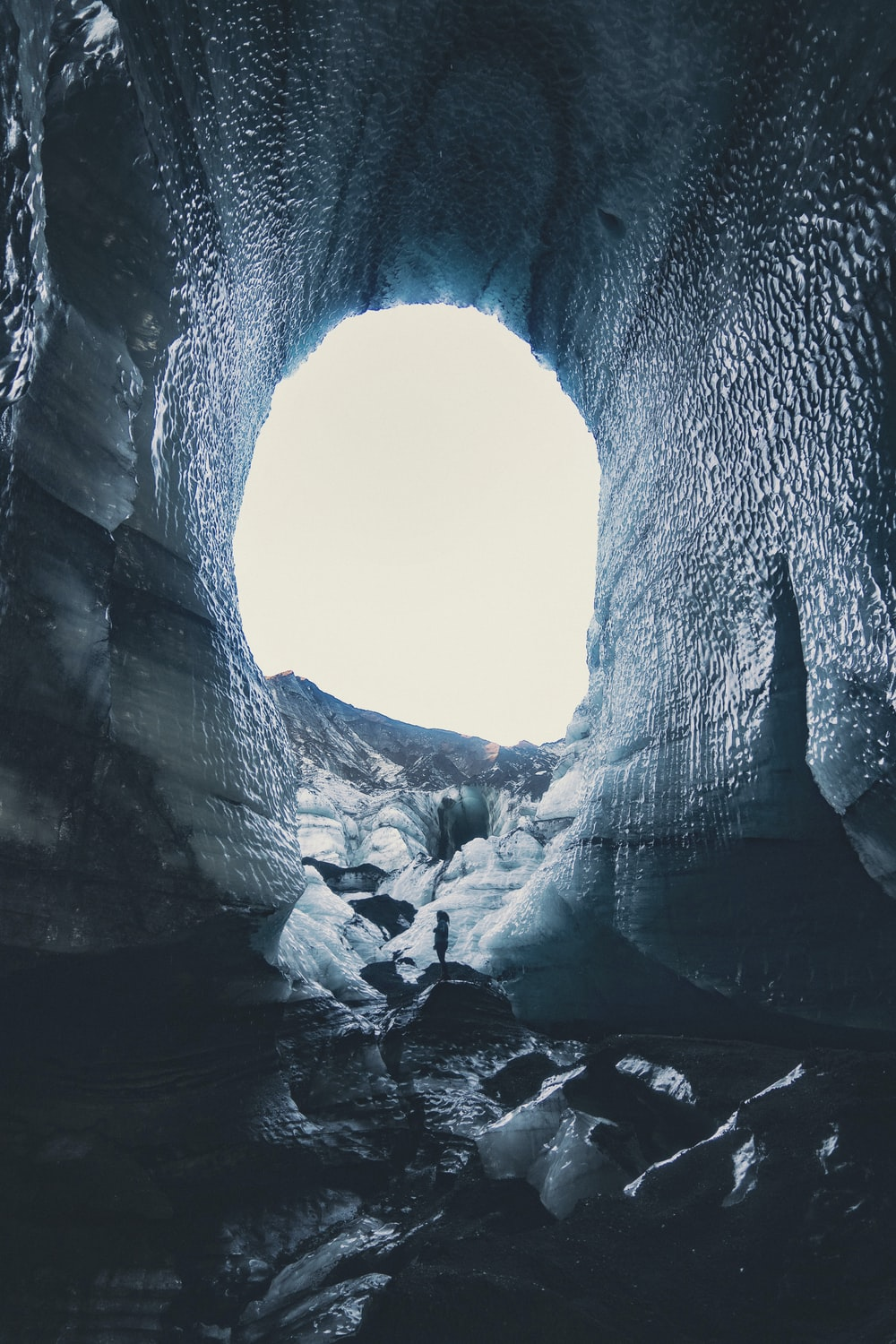 cave with snow during daytime