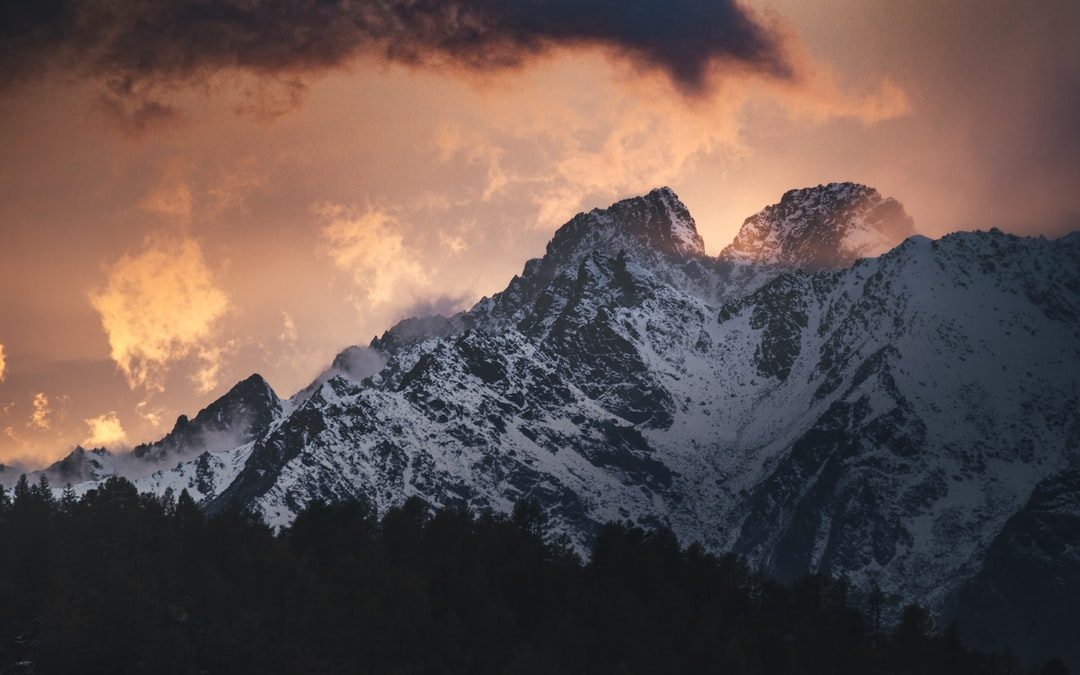 Burning Mountains. Italian Alps In Clouds. - unsplash