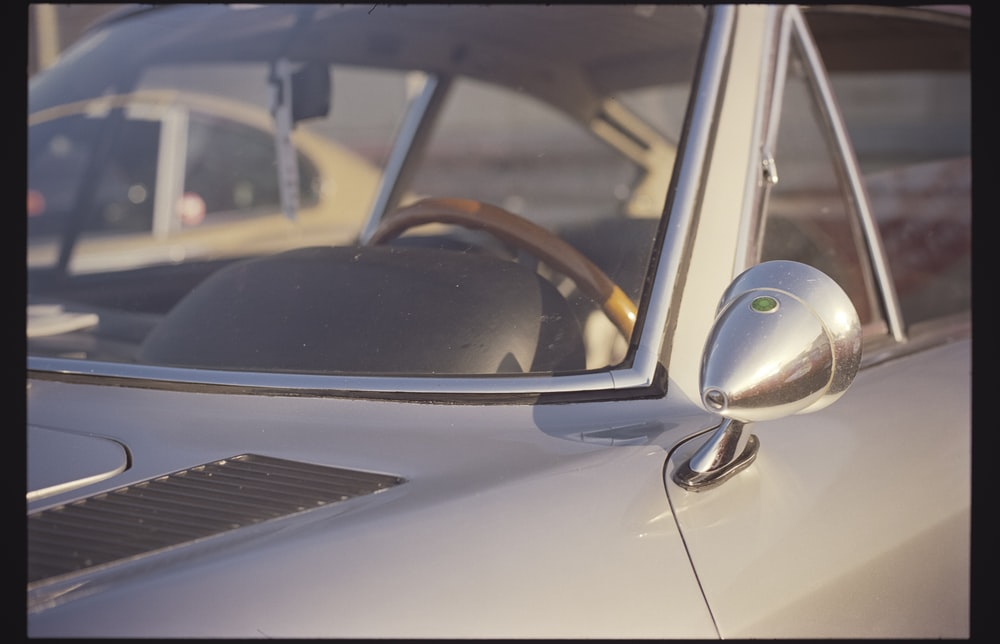 silver car with side mirror
