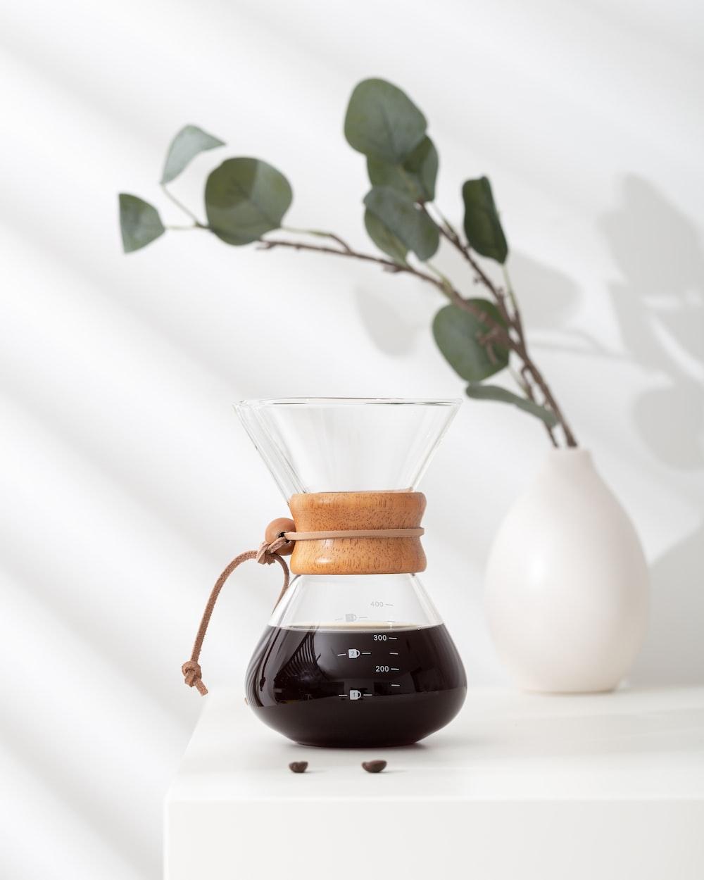 white ceramic vase with brown liquid