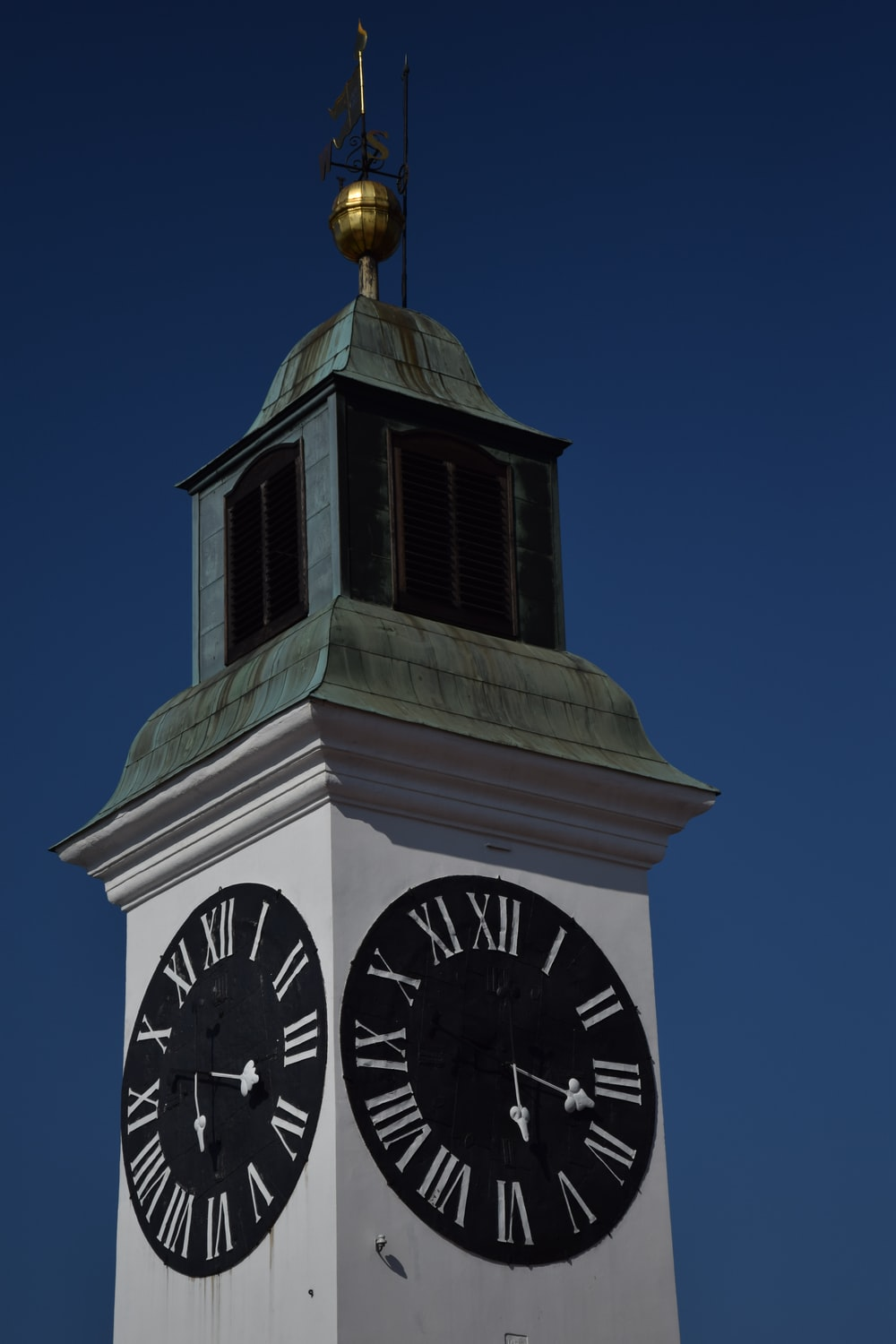 white and black clock tower under blue sky during daytime