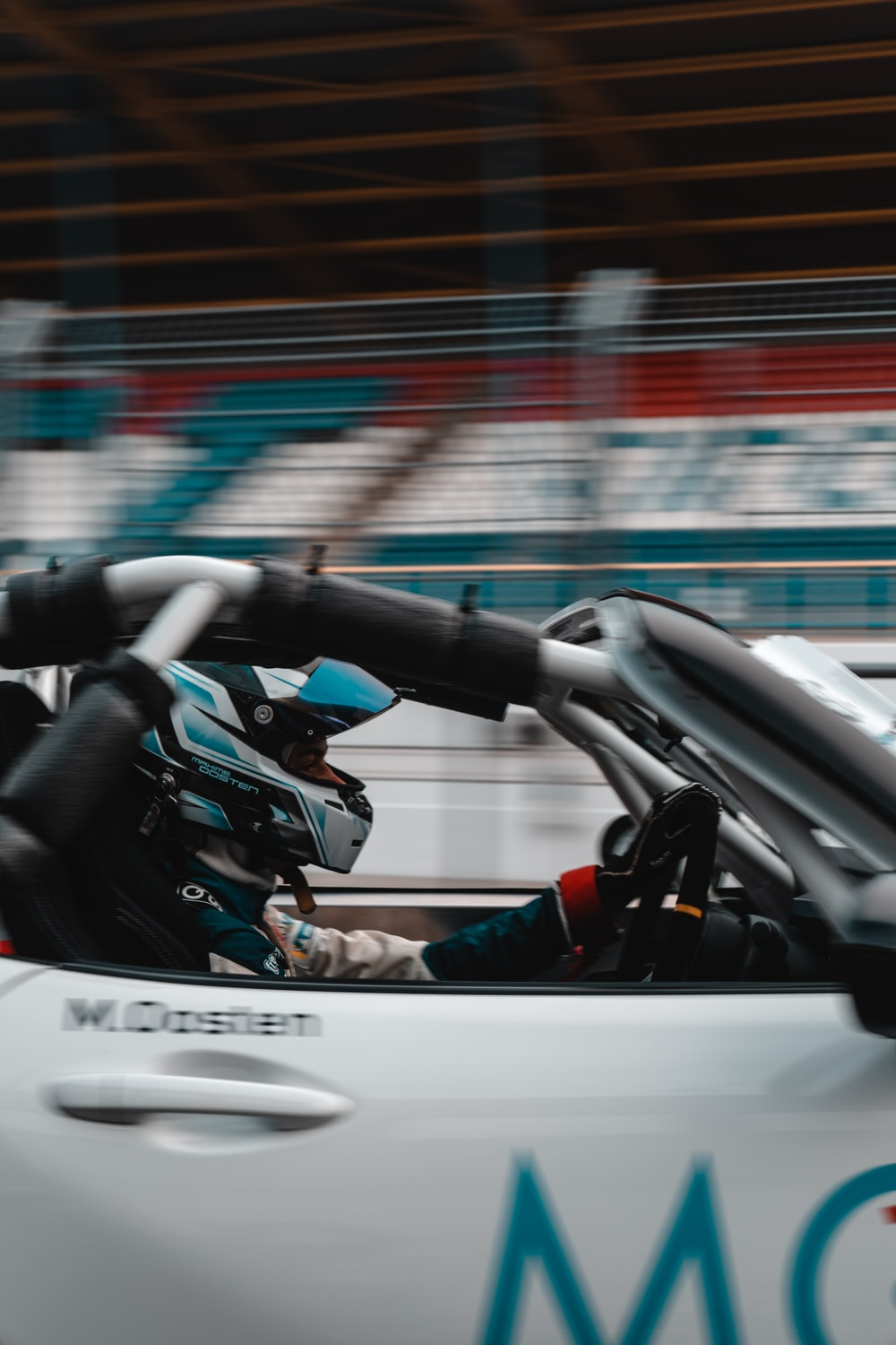 man in blue jacket riding on white and black go kart