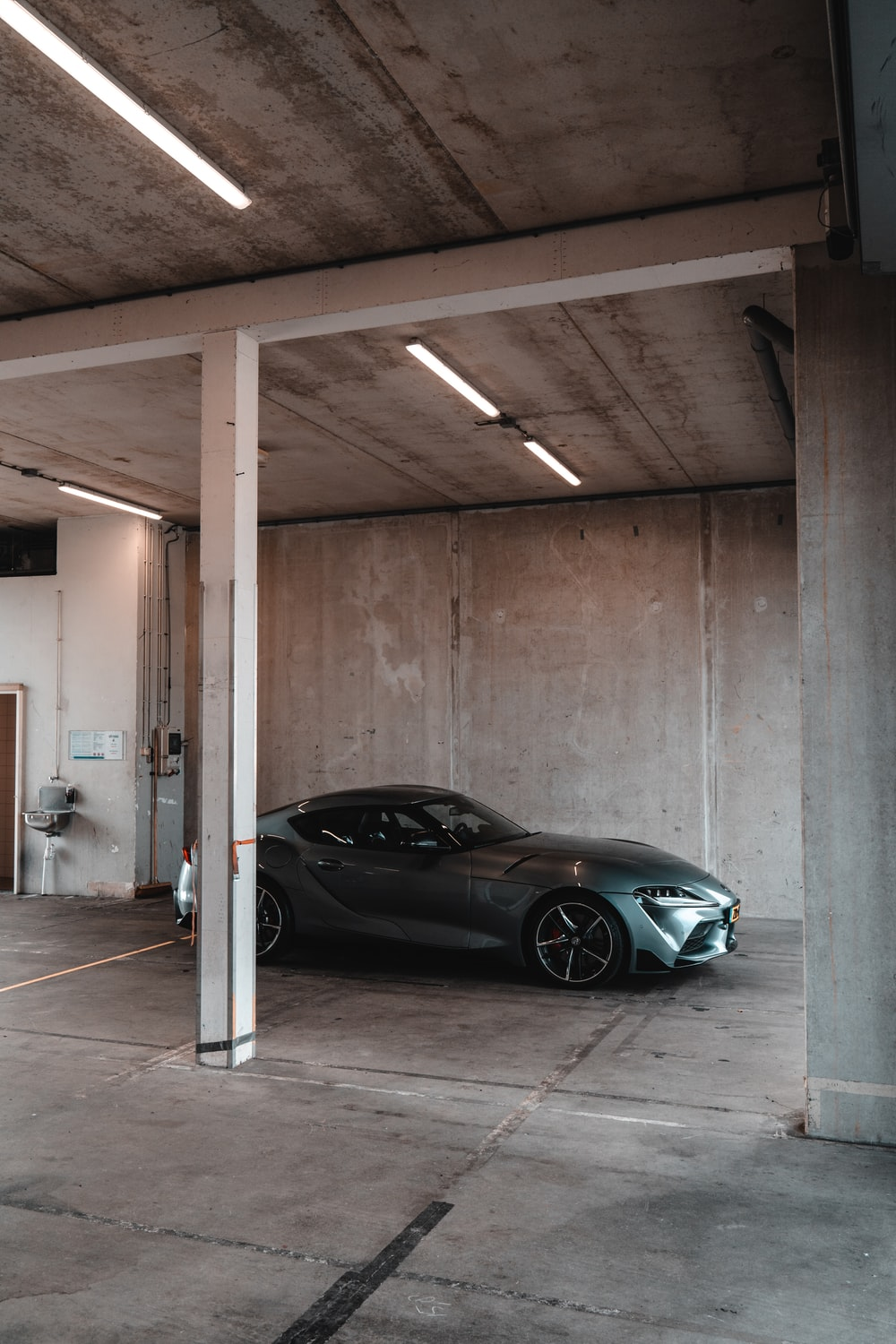 black coupe parked in garage