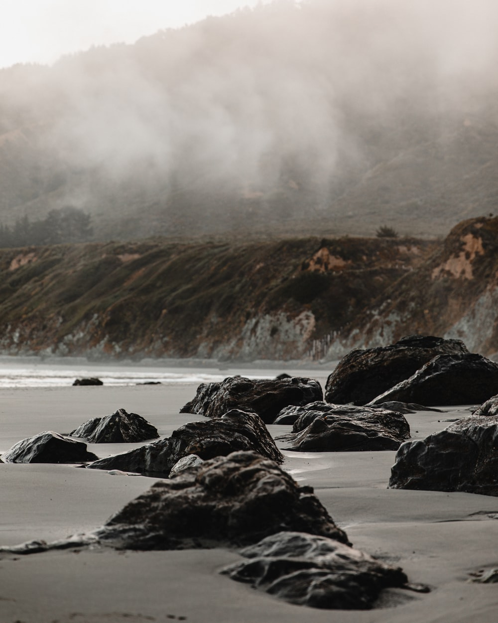 rocky shore with sea waves crashing on rocks