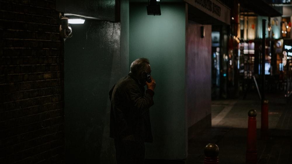 woman in black jacket standing near door