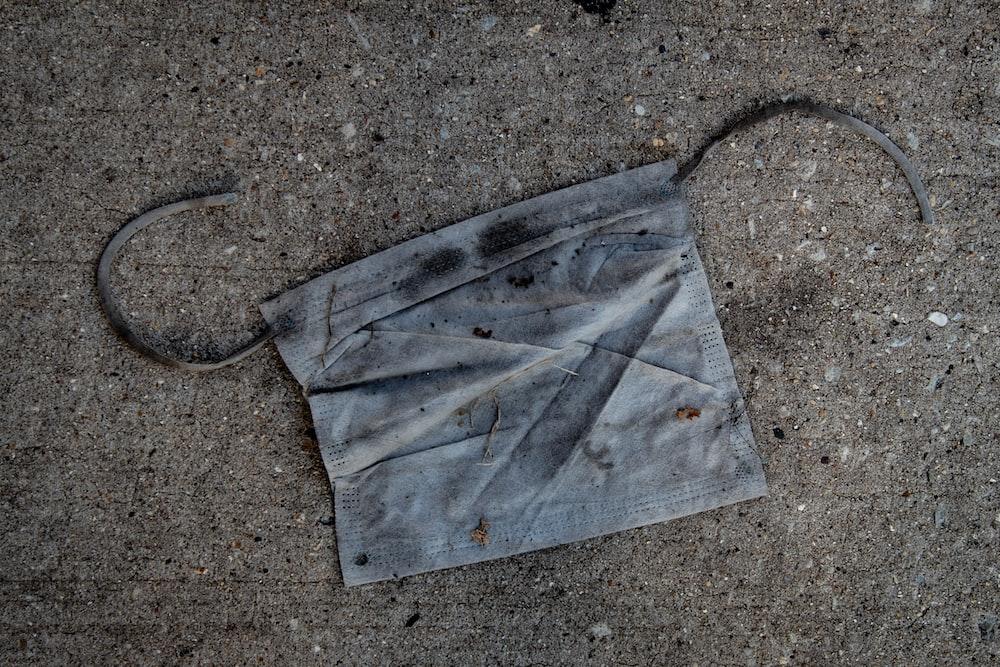 gray paper bag on gray concrete floor