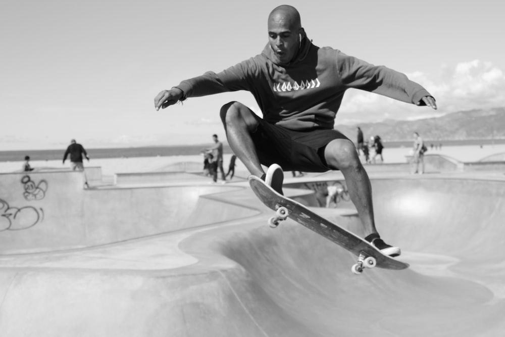 man in black hoodie and black pants riding skateboard