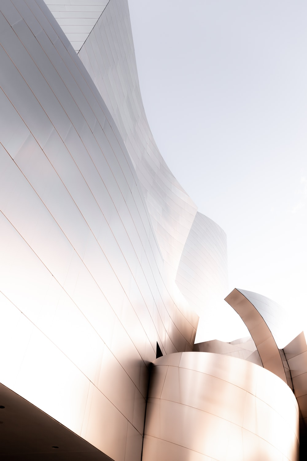 white spiral building in grayscale photography