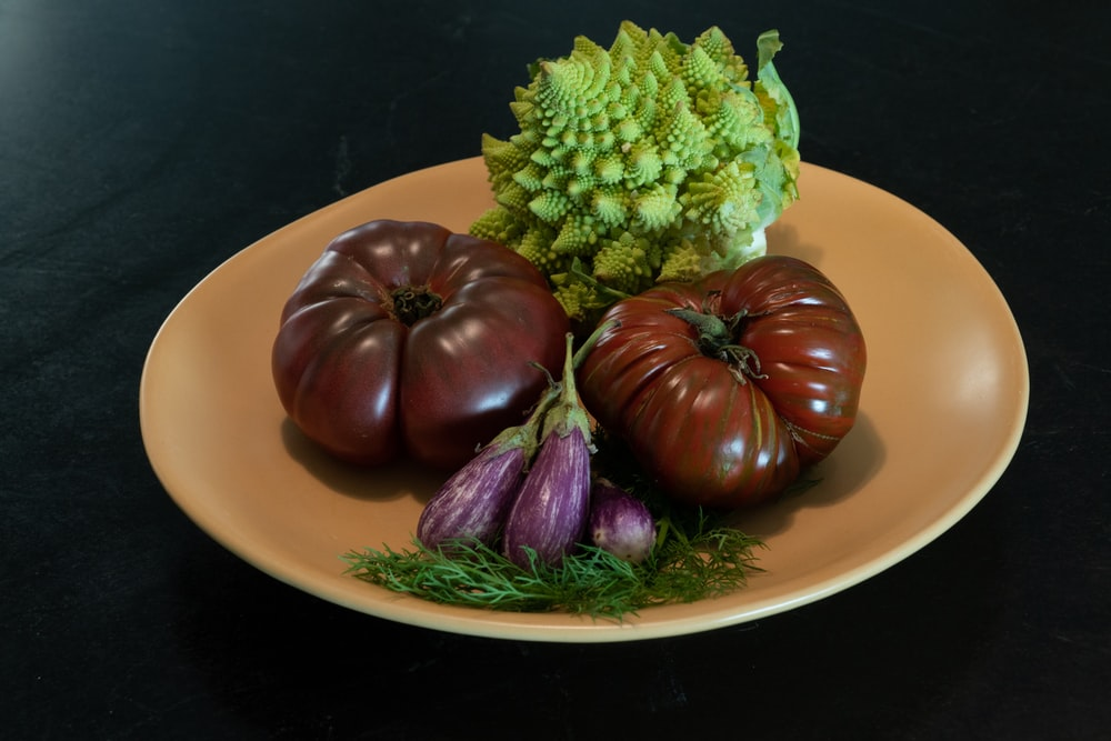 green and purple vegetable on white ceramic plate