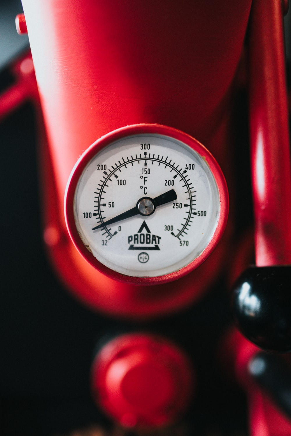 red and white gauge at 200