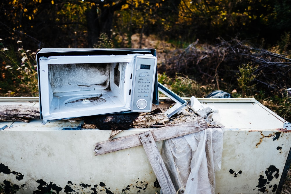 white microwave oven on white wooden table