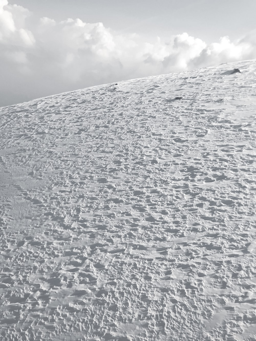 white snow covered mountain under white clouds during daytime