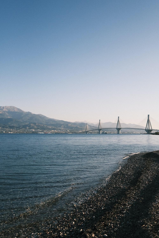white bridge over the sea during daytime