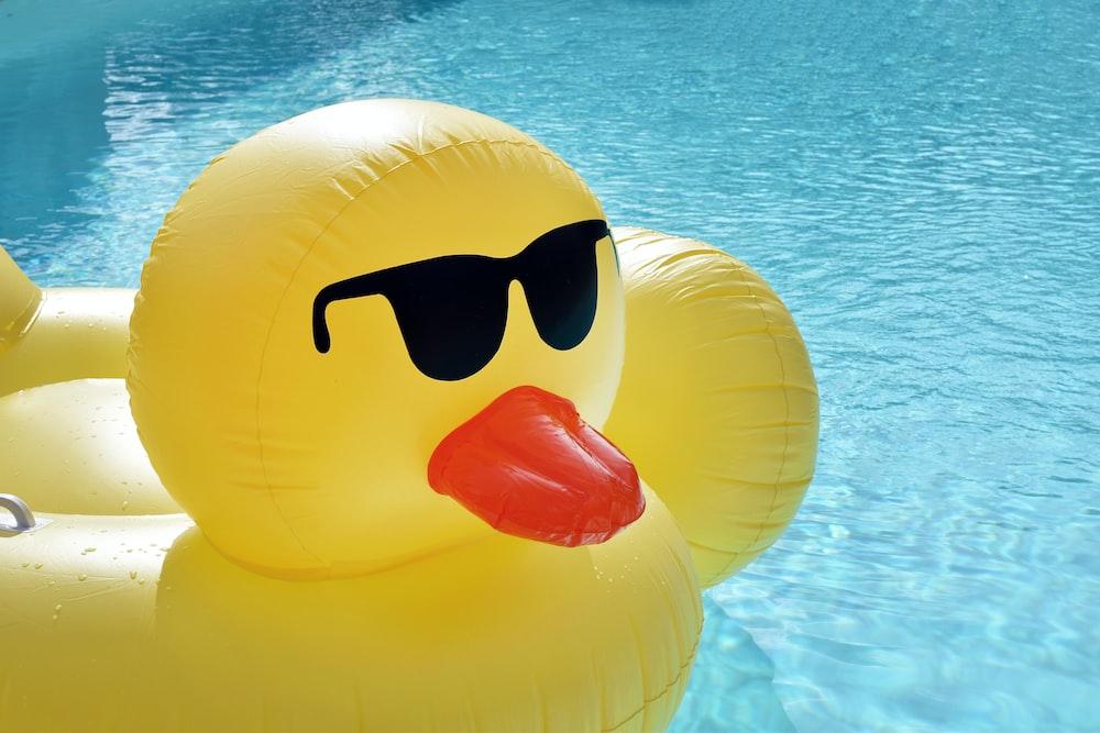 yellow inflatable balloon floating on water