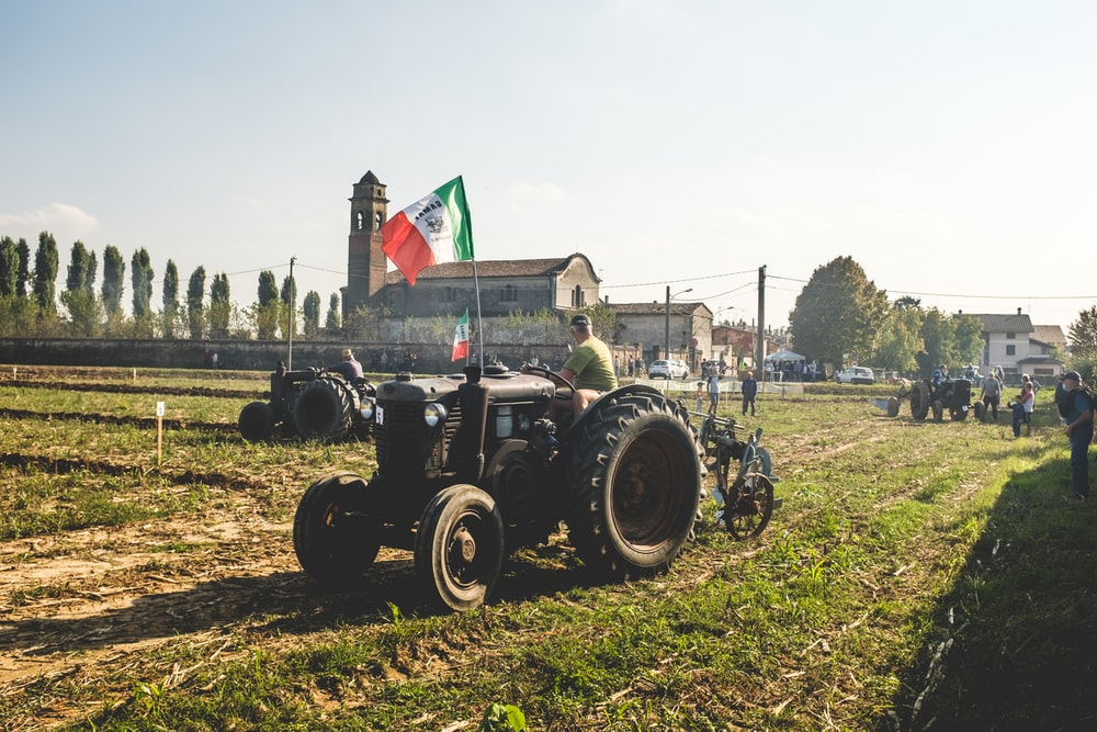 black tractor on green grass field during daytime