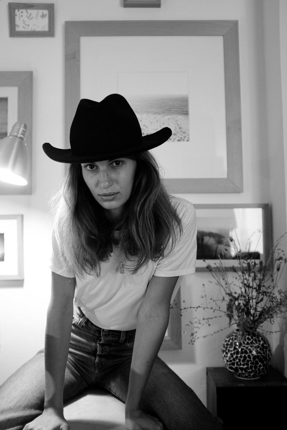 woman in white shirt and black cowboy hat