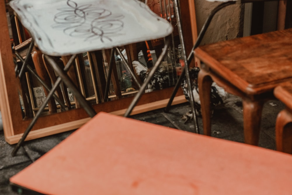 brown wooden table beside white chair