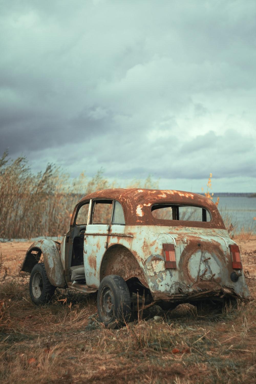 vintage car on brown field during daytime