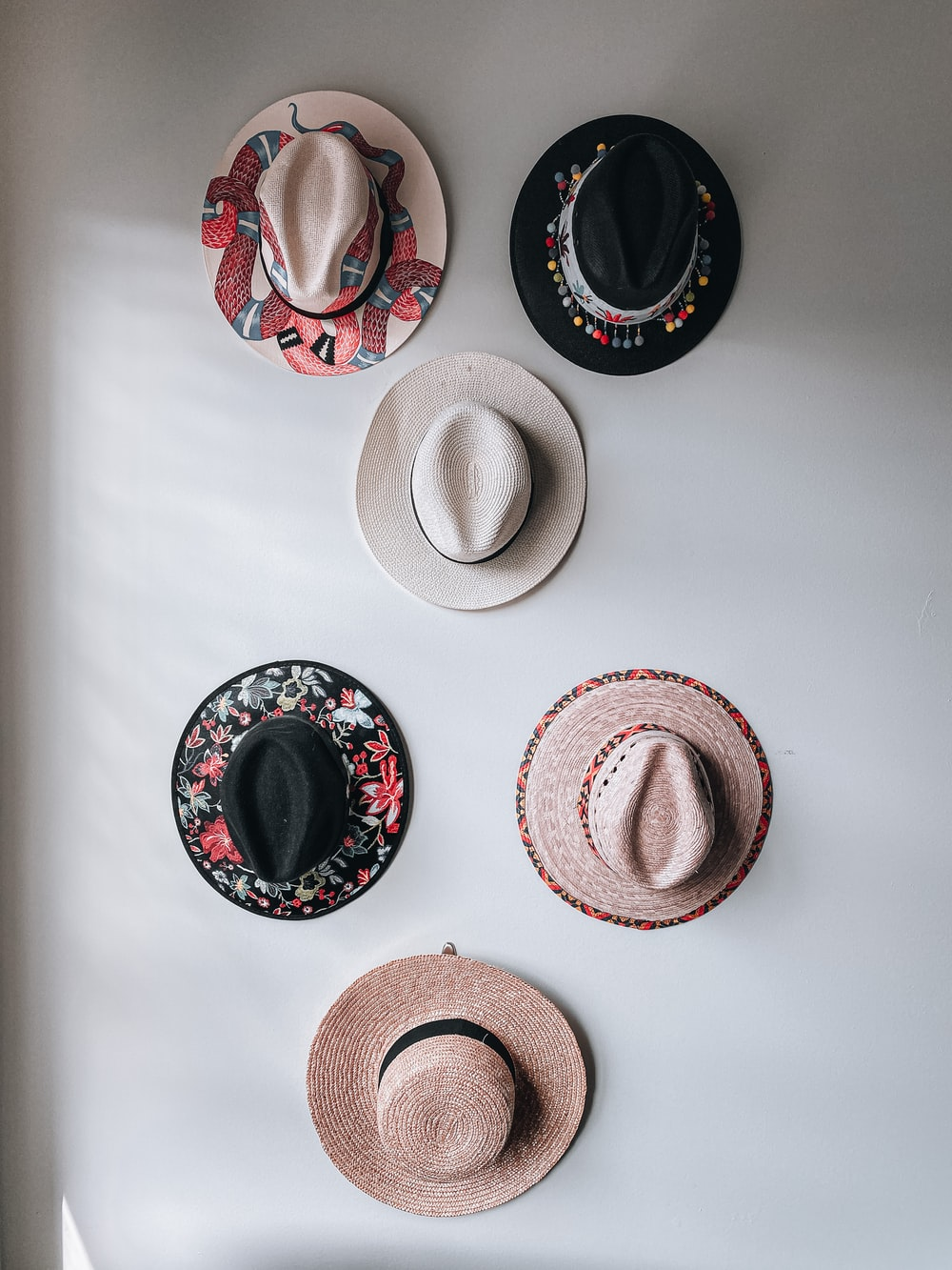 brown and white fedora hats