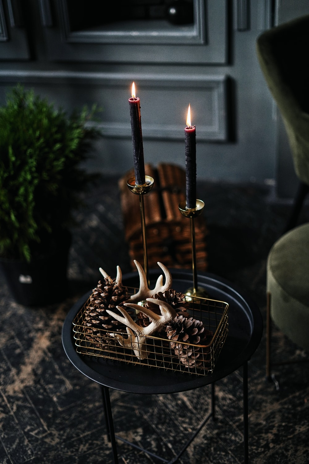 gold steel candle holder with lighted candles