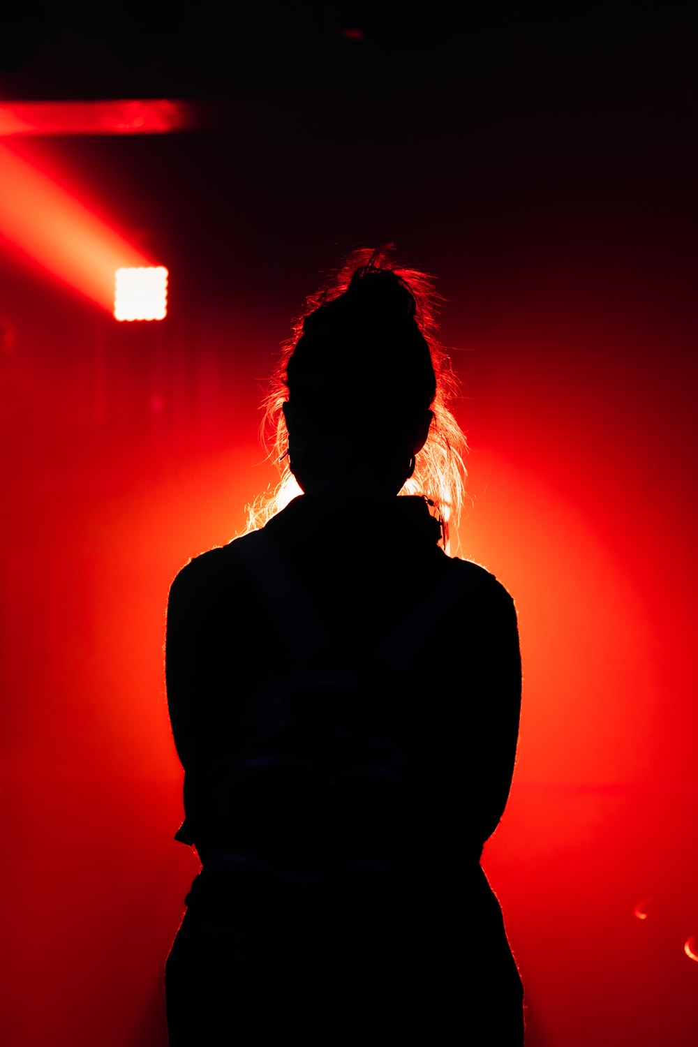 silhouette of person with red light