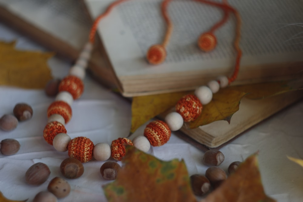 brown and white beaded necklace on brown wooden board