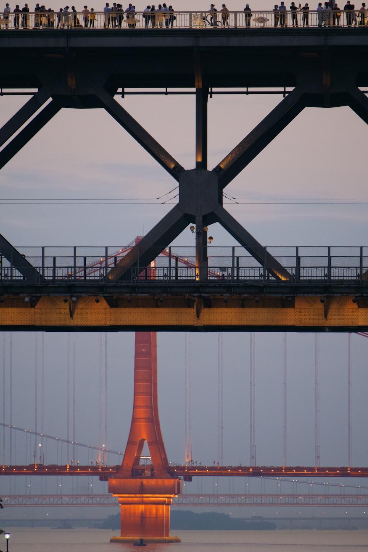 brown metal bridge under blue sky during daytime