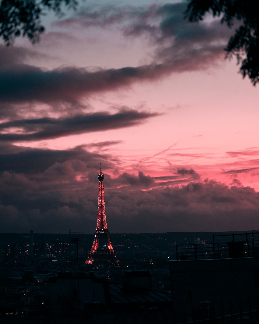 red and white tower under cloudy sky during sunset