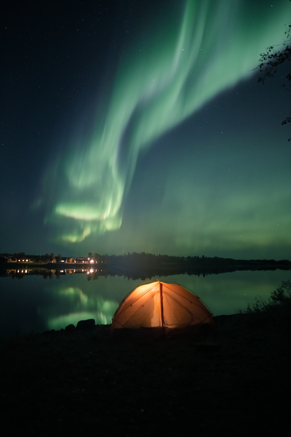 white tent near body of water during night time