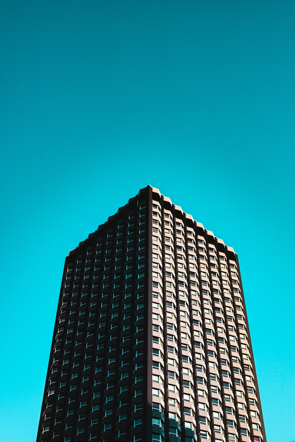 black and gray concrete building under blue sky during daytime