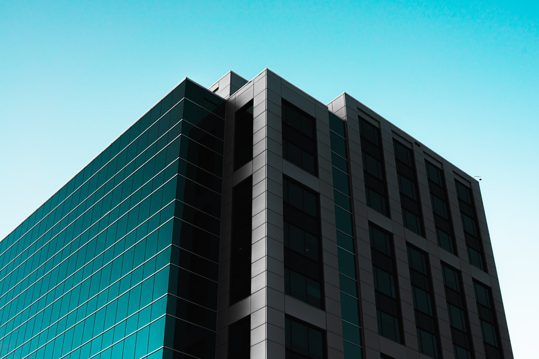 White and Green Concrete Building Under Blue Sky During Daytime - unsplash