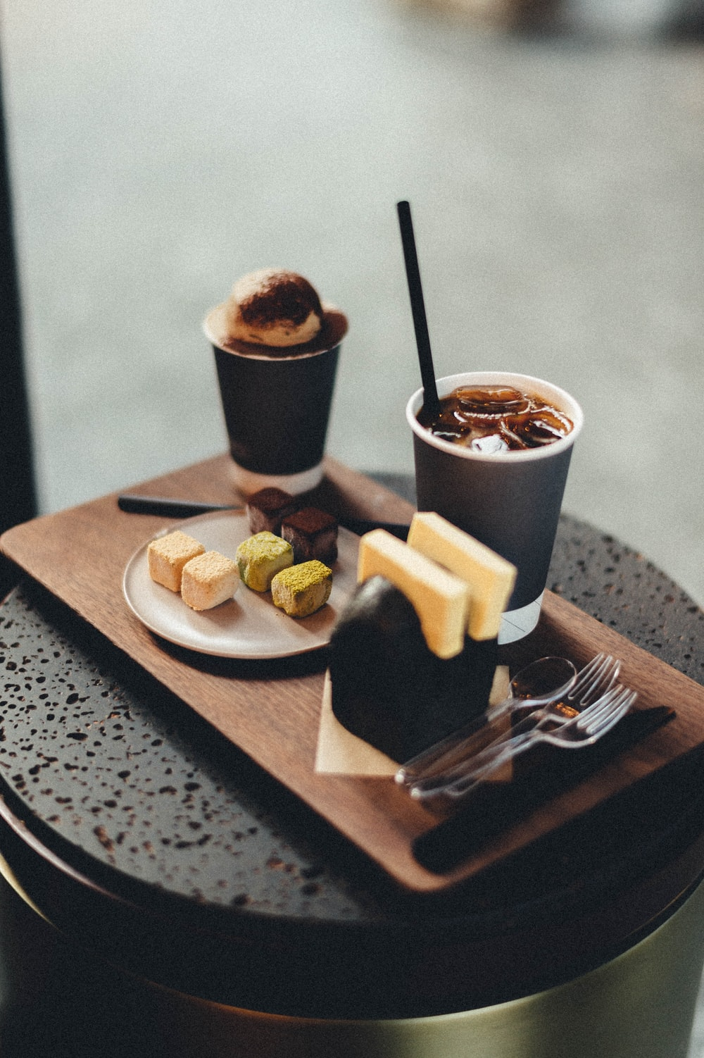 sliced bread and coffee on brown wooden tray
