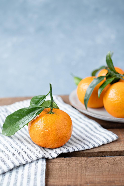 orange fruit on white table cloth