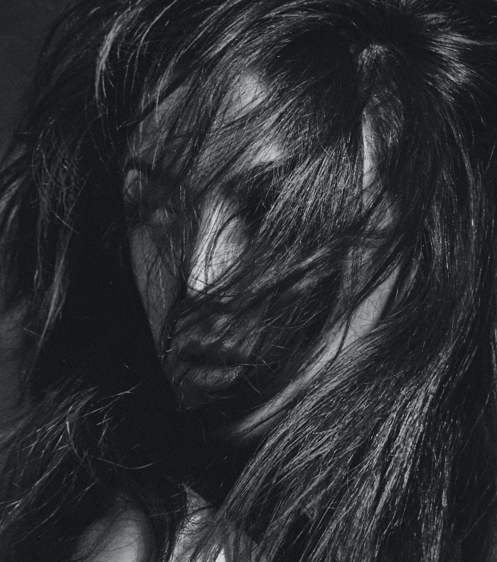 womans black hair with black hair