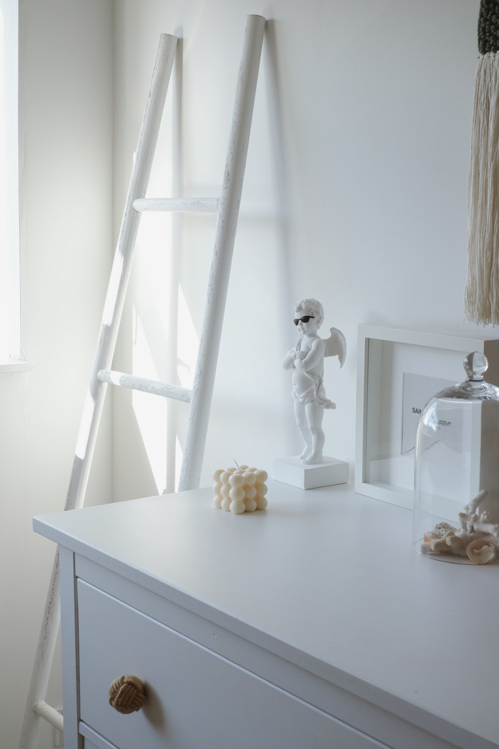 clear glass figurine on table