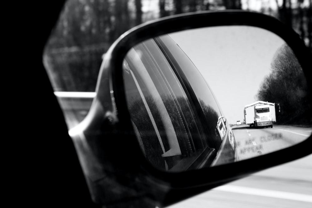 car side mirror showing car