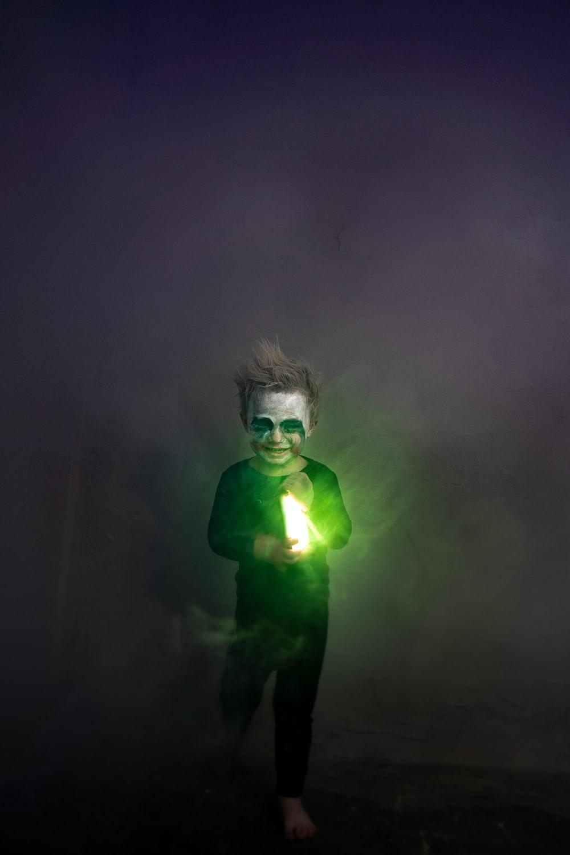 man in green shirt singing