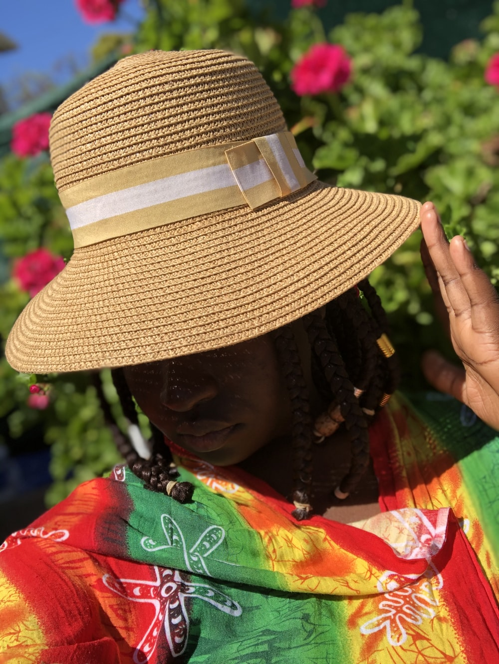 woman in brown and white sun hat