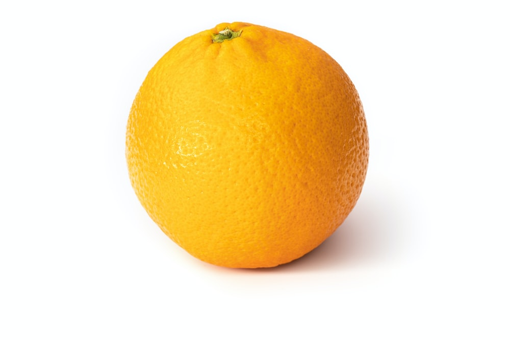 orange fruit on white surface