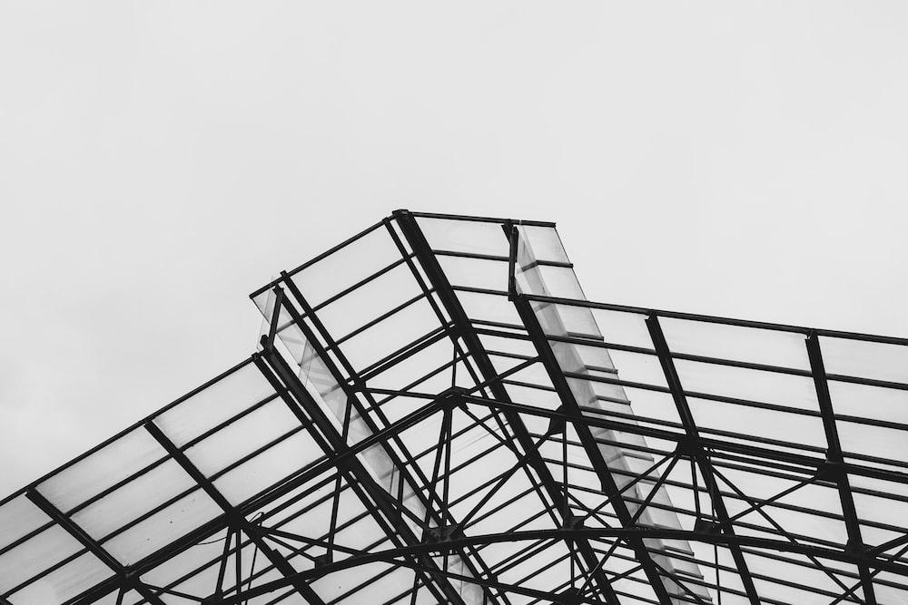 black metal frame under white sky